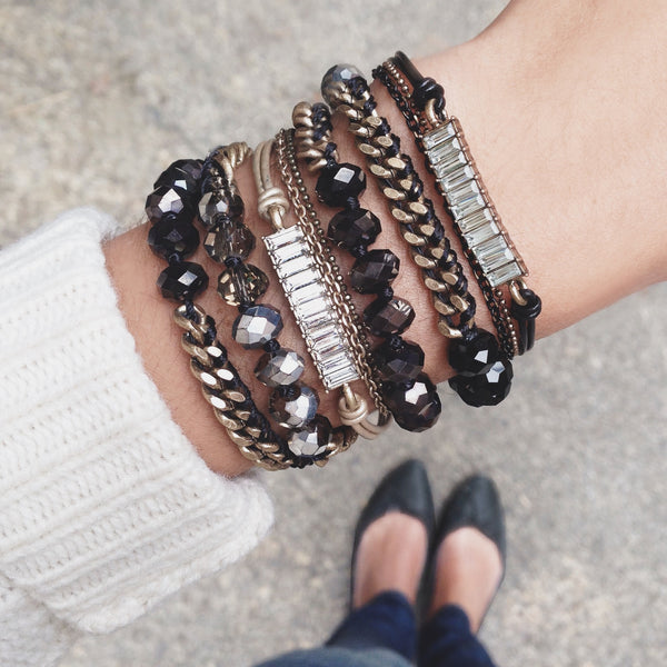 chloe + isabel by Rachel Nevarez layered bracelet look black tones
