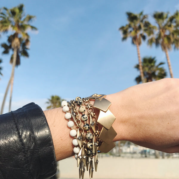 chloe + isabel by Rachel Nevarez layered bracelet look golds