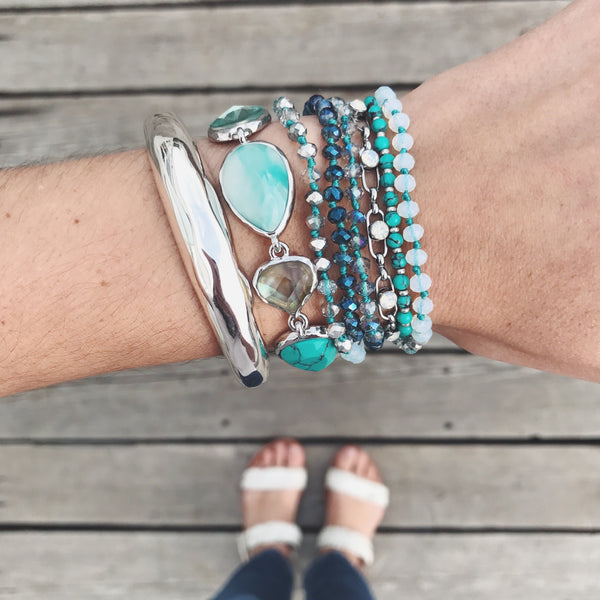 chloe + isabel by Rachel Nevarez layered bracelet look aqua tones