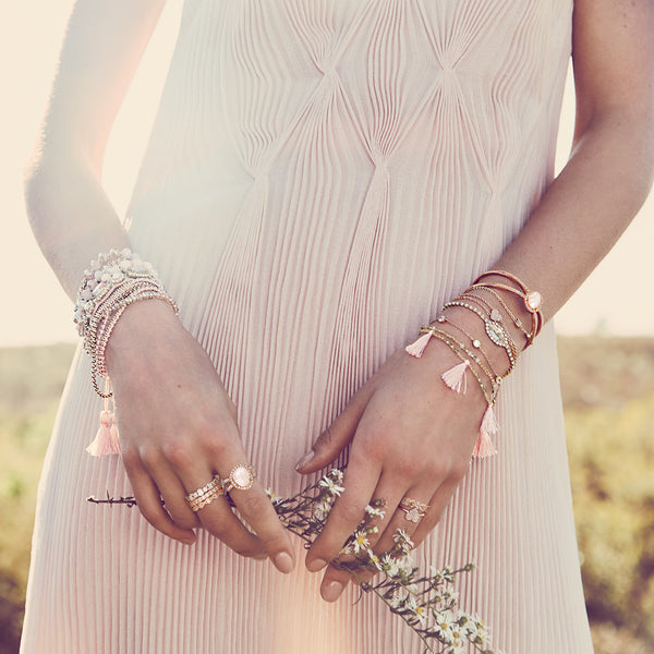 chloe + isabel by Rachel Nevarez layered bracelet look pink tones
