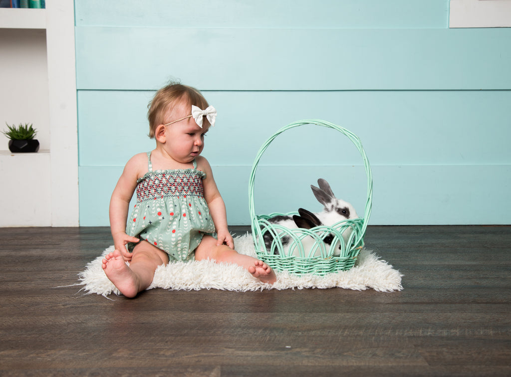 Baby's First Easter in handmade bubble romper by Duchess and Goose with real bunnies