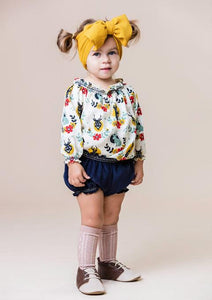 toddler girl wearing designer stretch head wrap in honey mustard