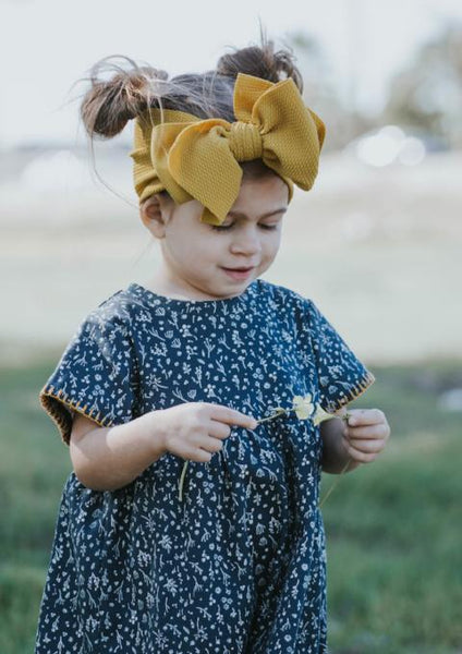 toddler girl wearing honey mustard head wrap with navy handmade dress