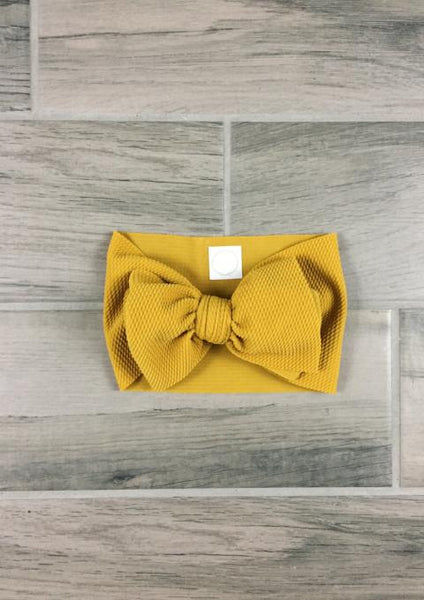 infant and toddler designer head wrap and bow in color honey mustard