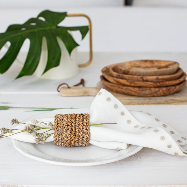 Cream linen napkin in napkin ring from Artha Collections