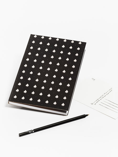 Black notebook with linden leaves