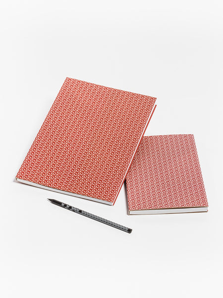 Red notebook with linden blossoms