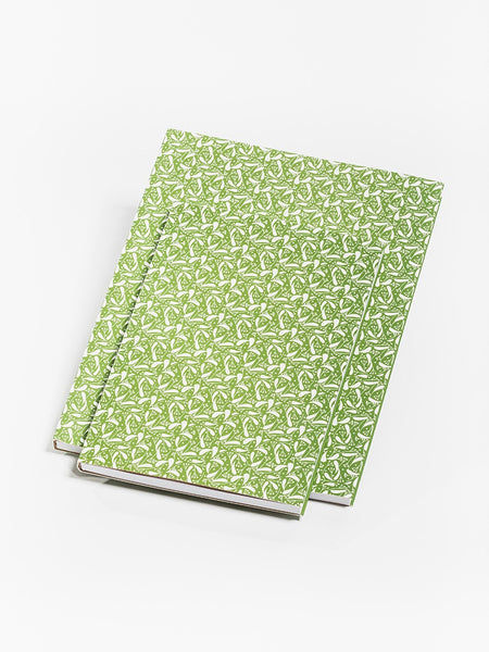 Green notebook with linden fruit