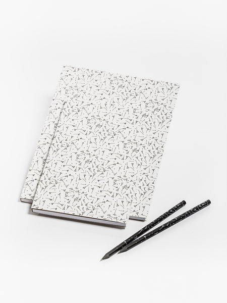White notebook with linden fruits