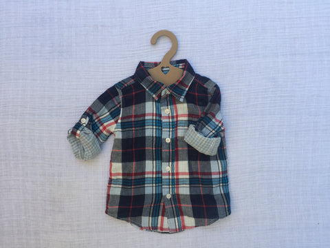 baby boy flannel shirt hanging on recycled baby hanger with heart design die cut, flat lay photo style