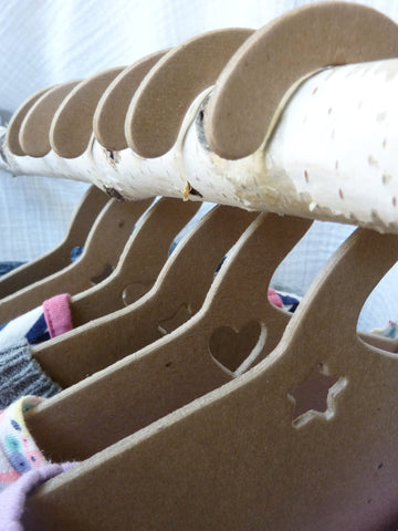 eco friendly and recycled hangers for baby and kids' closet, hangers on birch branch rod