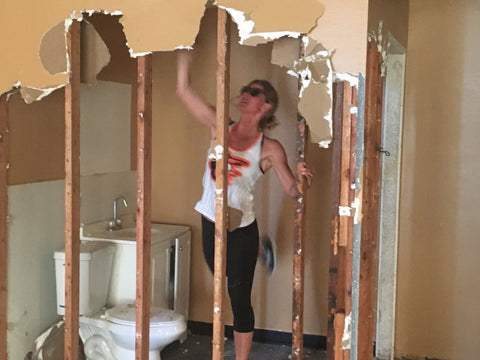 Owner Ellen taking out some drywall at the new Steady State location