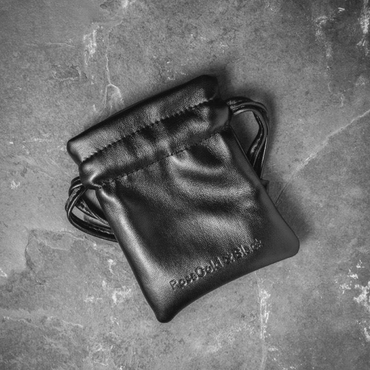 Leather pouch for Our Men's Double Leather Bracelet with Black Leather and a Matte Black Adjustable Clasp Engraved with our Signature RG&B Logo.