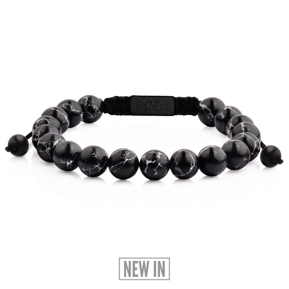 Black Stone Bead Bracelet - Our Black Stone Bead Bracelet Features Natural Stones, Waxed Cord and Brushed Black Steel Hardware. A Beautiful Addition to any Collection.