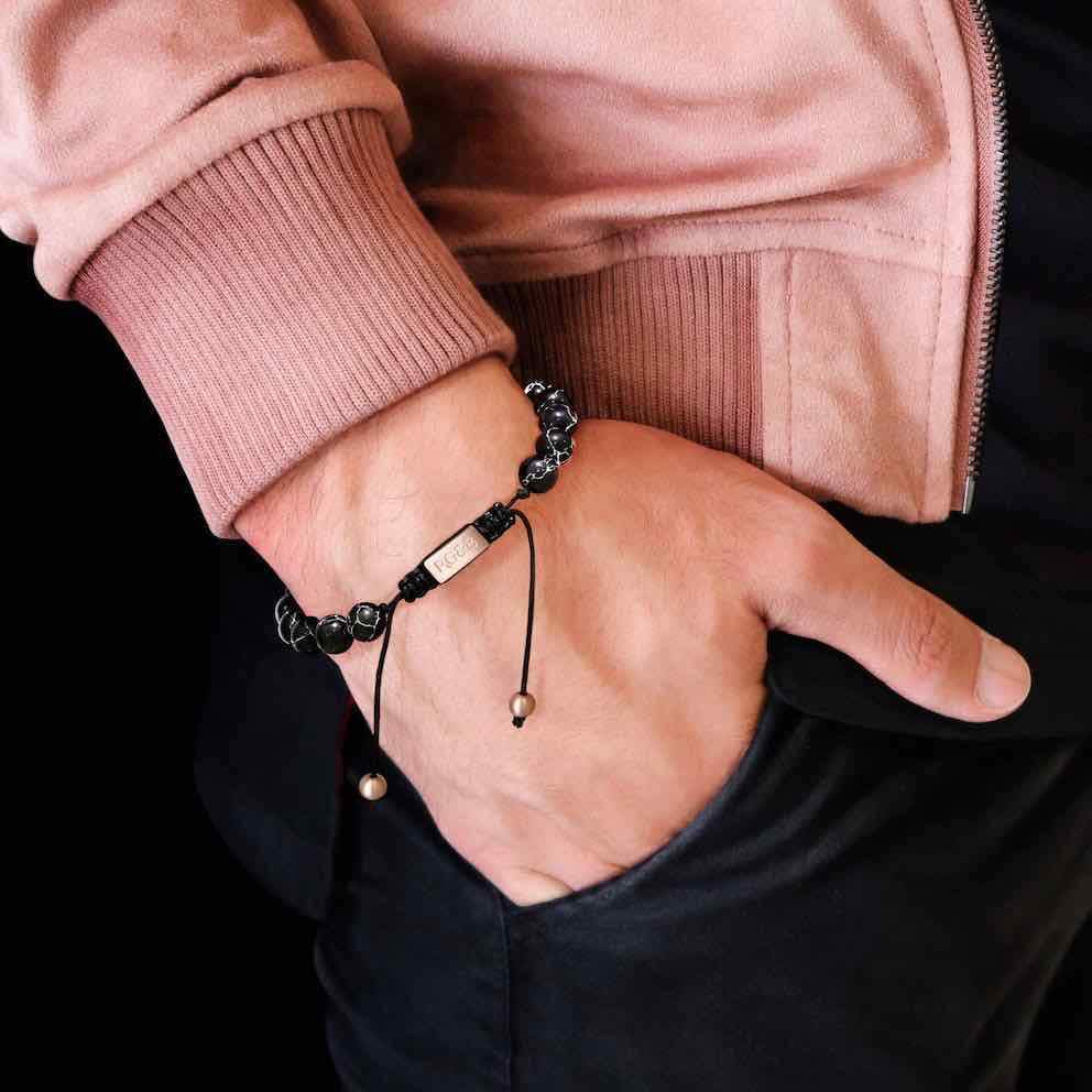 Black Stone Bead Bracelet - Our Black Stone Bead Bracelet Features Natural Stones, Waxed Cord and Brushed Rose Gold Steel Hardware. A Beautiful Addition to any Collection.