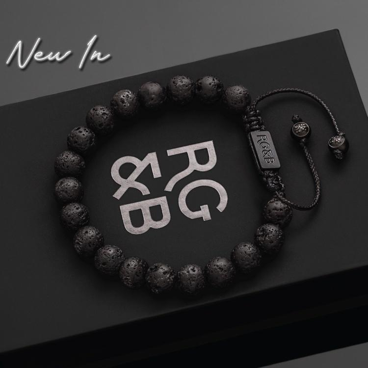 Lava Stone Bead Bracelet - Our Lava Stone Bead Bracelet Features Natural Stones, Waxed Cord and Brushed Black Steel Hardware, Engraved with the Signature RG&B Logo.