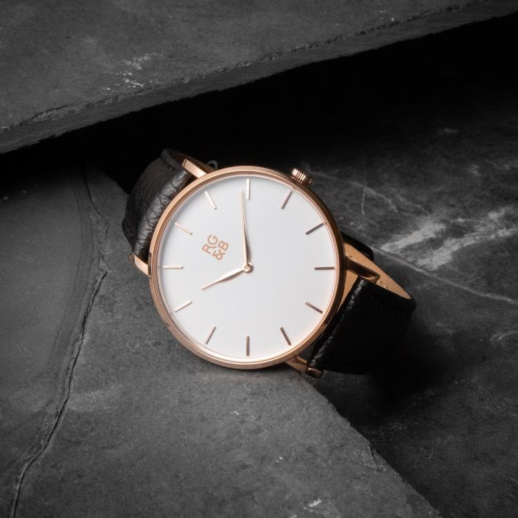 Rose Gold Minimal Watch - Explore our Classic Minimal Watch in Rose Gold & Black. Featuring a Polished Rose Gold Case, Hands & Hour Markers, a White Dial and a Black Leather Strap.