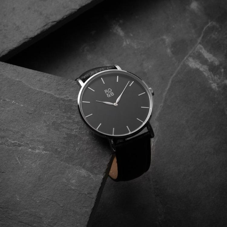 Silver & Black Minimal Watch - Explore our Classic Minimal Watch in Silver & Black. Featuring a Polished Silver Case, Hands & Hour Markers, a Black Dial and a Black Leather Strap.