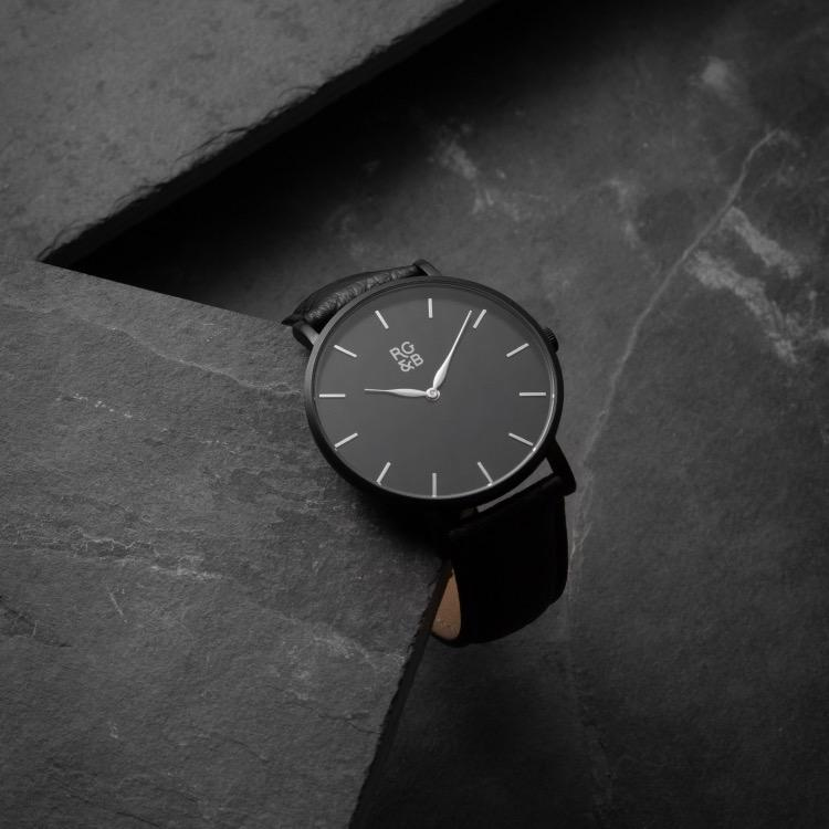 Black Minimal Watch - Explore our Classic Minimal Watch in All Black. Featuring a Brushed Black Case, Gunmetal Hands & Hour Markers, a Black Dial and a Black Leather Strap.