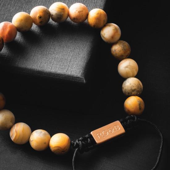 Crazy Lace Agate Bracelet - Our Crazy Lace Agate Bracelet Features Natural Stones, Waxed Cord and Brushed Rose Gold Steel Hardware. A Beautiful Addition to any Collection.