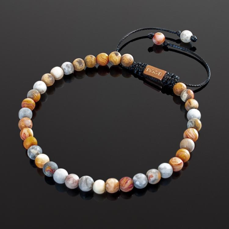 Our Crazy Lace Agate Bead Bracelet Features Natural Stones, Waxed Cord and Brushed Rose Gold Steel Hardware. A Beautiful Addition to any Collection.