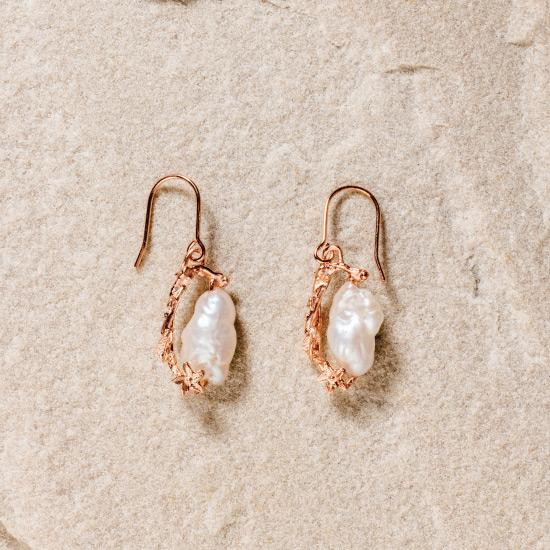 Women's Pearl Earrings - Fine wire hook earring featuring a uniquely molded Flower combined with a precious rough pearl to form a timelessly beautiful pendant. Fine brass, plated with gold or rose gold.
