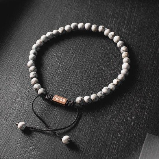 Minimal Grey Jasper Bead Bracelet - Our Minimal Grey Jasper Bead Bracelet Features Natural Stones, Waxed Cord and Brushed Rose Gold Steel Hardware. A Beautiful Addition to any Collection.