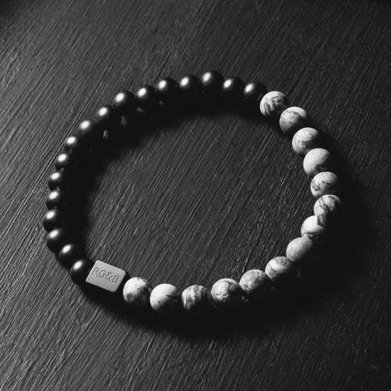 Grey Jasper Stone Bead Bracelet - Our Grey Jasper Stone Bead Bracelet Features 6mm Natural Stones, Premium Elastic Cord and Brushed Black Hardware. A Beautiful Addition to any Collection.