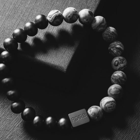 Grey Jasper Stone Bead Bracelet - Our Grey Jasper Stone Bead Bracelet Features 8mm Natural Stones, Premium Elastic Cord and Brushed Black Hardware. A Beautiful Addition to any Collection.