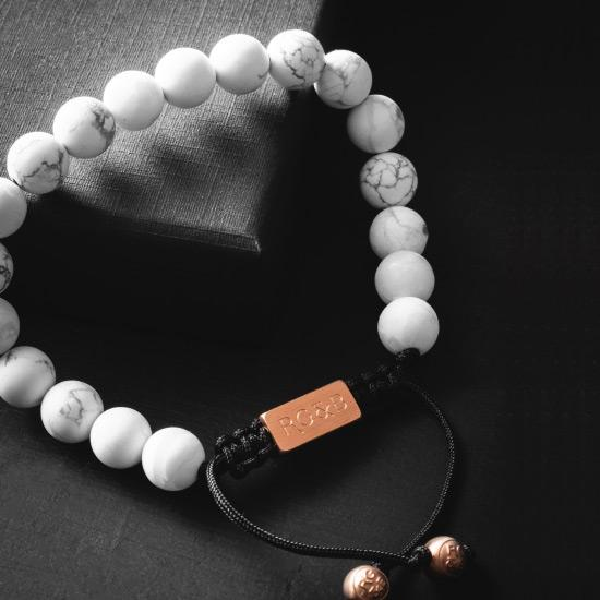 Howlite Bead Bracelet - Our Howlite Bead Bracelet Features Natural Stones, Waxed Cord and Brushed Rose Gold Steel Hardware. A Beautiful Addition to any Collection.