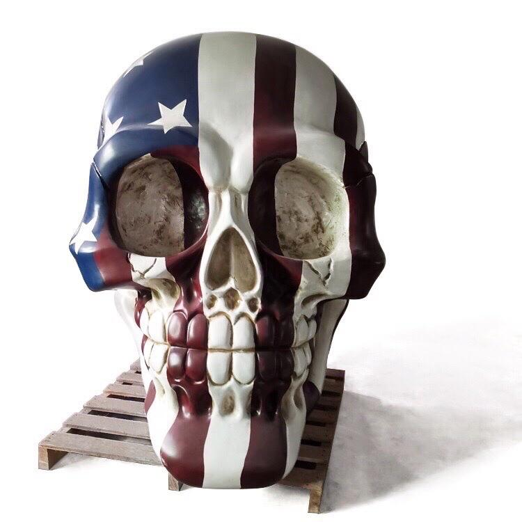 Giant Skull Sculpture (5 ft) - Our 5 foot Skull Sculpture finished with the Star Spangled Banner is the perfect piece for any patriot looking to make a statement. Made-to-order pieces are also available.