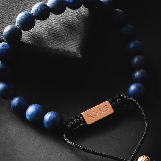 Lapis Lazuli Bracelet - Our Lapis Lazuli Bead Bracelet Features Natural Stones, Waxed Cord and Brushed Rose Gold Steel Hardware. A Beautiful Addition to any Collection.