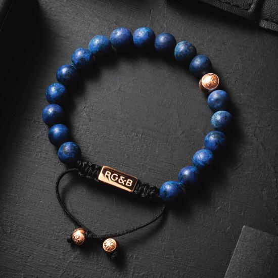 Premium Lapis Lazuli Bracelet - Our Premium Lapis Lazuli Bead Bracelet Features Natural Stones, Waxed Cord and Polished Rose Gold Steel Hardware. A Beautiful Addition to any Collection.