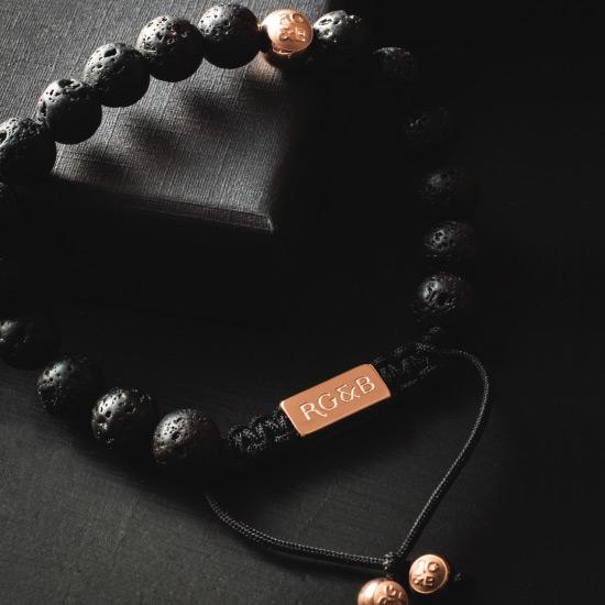 Premium Lava Stone Bead Bracelet - Our Premium Lava Stone Bead Bracelet Features Natural Stones, Waxed Cord and Polished Rose Gold Steel Hardware. A Beautiful Addition to any Collection.