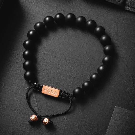 Matte Black Bracelet - Our Matte Black Bead Bracelet Features Natural Stones, Waxed Cord and Brushed Rose Gold Steel Hardware. A Beautiful Addition to any Collection.