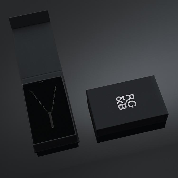 Box for our Signature Minimal Bar Necklace in All Black which has been crafted with minimalist styling in mind. An essential piece for any wardrobe.