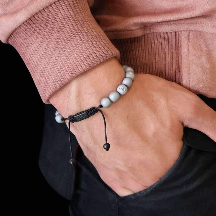 Smile Agate Bead Bracelet - Our Smile Agate Bead Bracelet Features Natural Stones, Waxed Cord and Brushed Black Steel Hardware. A Beautiful Addition to any Collection.