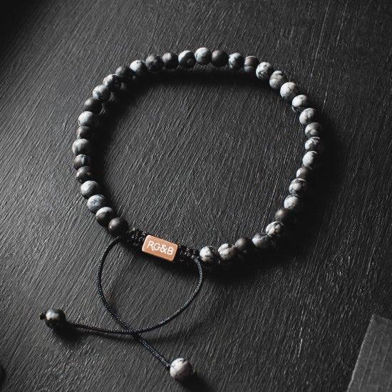 Minimal Snowflake Obsidian Bead Bracelet - Our Minimal Snowflake Bead Bracelet Features Natural Stones, Waxed Cord and Brushed Rose Gold Steel Hardware. A Beautiful Addition to any Collection.