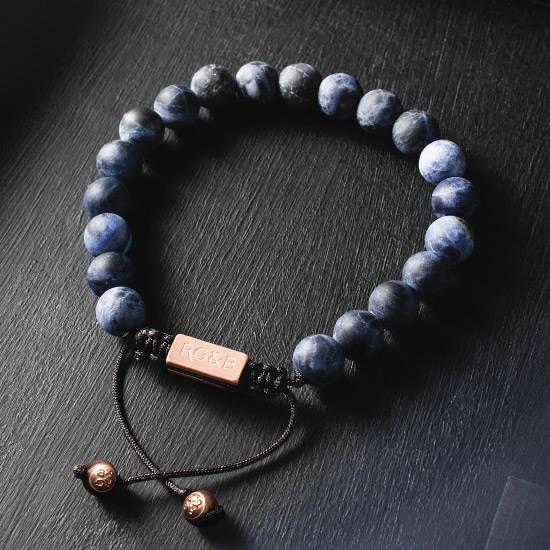 Sodalite Bracelet - Our Sodalite Bead Bracelet Features Natural Stones, Waxed Cord and Brushed Rose Gold Steel Hardware. A Beautiful Addition to any Collection.