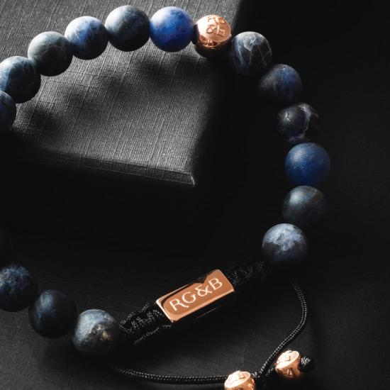 Premium Sodalite Bracelet - Our Premium Sodalite Bead Bracelet Features Natural Stones, Waxed Cord and Polished Rose Gold Steel Hardware. A Beautiful Addition to any Collection.