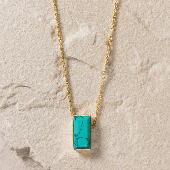 Turquoise Necklace - Finely handcrafted gold chain necklace that flows naturally into a Turquoise gemstone.