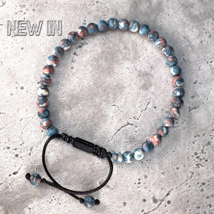 Tuscan Bead Bracelet - Our Tuscan Bead Bracelet Features Natural Stones, Waxed Cord and Brushed Black Steel Hardware. A Beautiful Addition to any Collection.