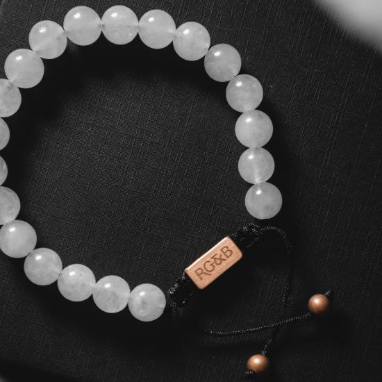 White Jade Bracelet - Our White Jade Bead Bracelet Features Natural Stones, Waxed Cord and Brushed Rose Gold Steel Hardware. A Beautiful Addition to any Collection.