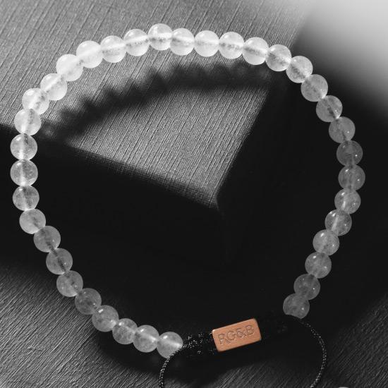 Minimal White Jade Bead Bracelet - Our Minimal White Jade Bead Bracelet Features Natural Stones, Waxed Cord and Brushed Rose Gold Steel Hardware. A Beautiful Addition to any Collection.