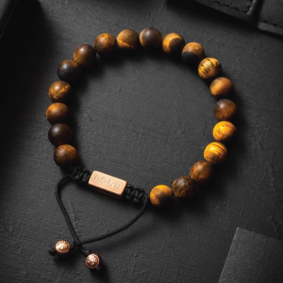 Tiger's Eye Bead Bracelet - Our Tiger's Eye Bead Bracelet Features Natural Stones, Waxed Cord and Brushed Rose Gold Steel Hardware. A Beautiful Addition to any Collection.