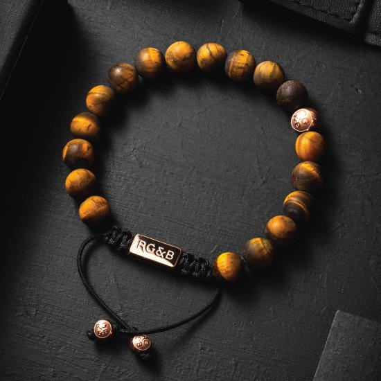 Premium Tiger's Eye Bead Bracelet - Our Premium Tiger's Eye Bead Bracelet Features Natural Stones, Waxed Cord and Polished Rose Gold Steel Hardware. A Beautiful Addition to any Collection.