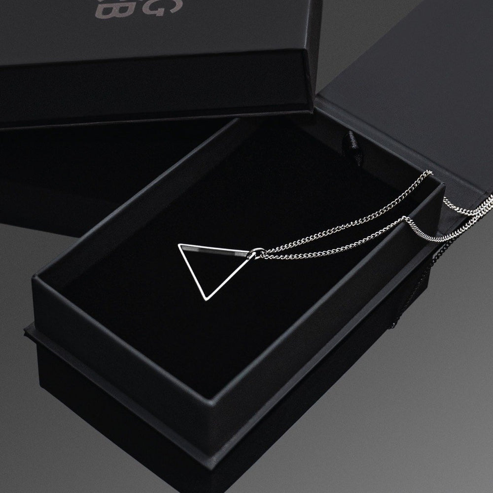 Silver Triangle Necklace - Our Silver Triangle Necklace features our Signature Triangle Pendant and Cuban Link Chain. The Perfect piece for any wardrobe.