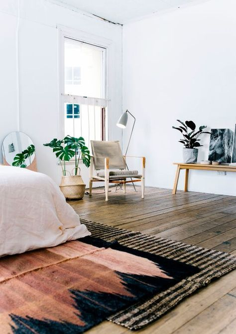 Layered rugs on wooden floors