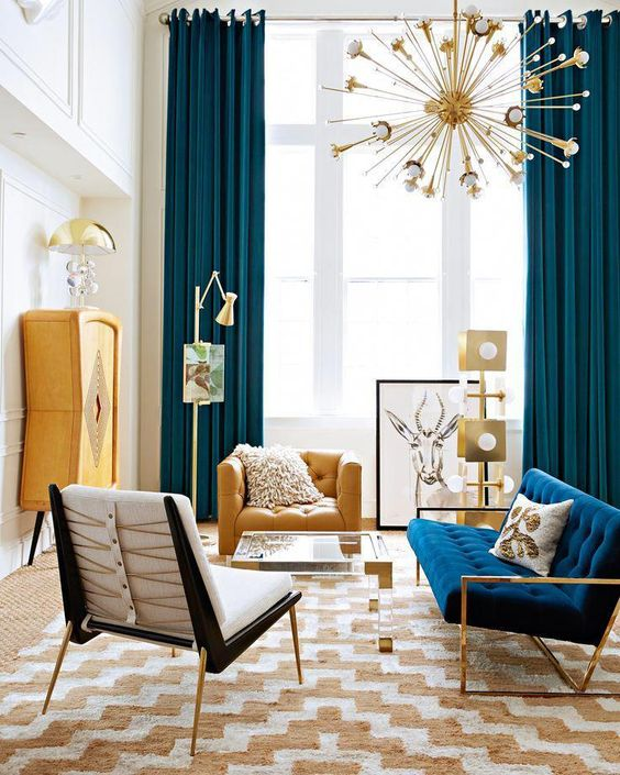Bold art deco interior with geometric area rug, angular furniture and gold light fixtures