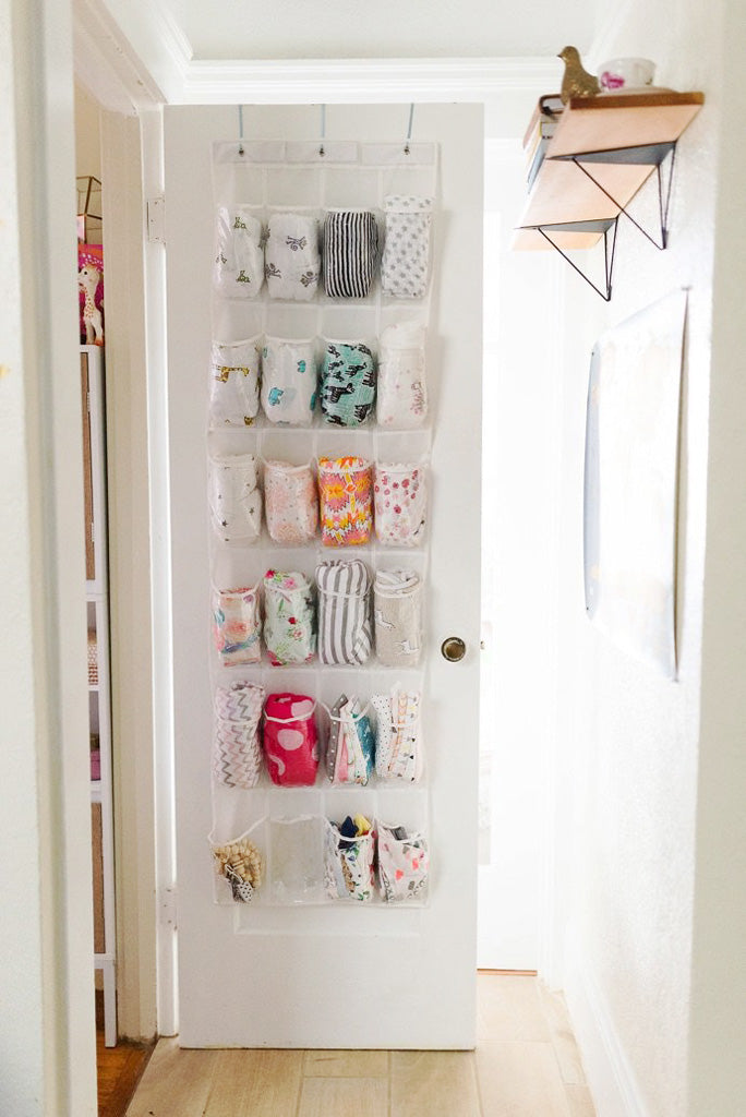 Nursery door with clothing organiser